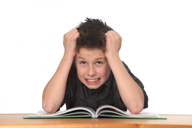 Frustration hits kid doing homework