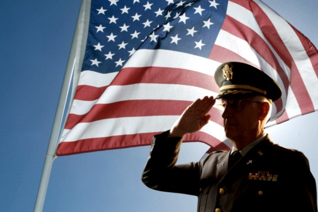 Veteran Saluting American Flag