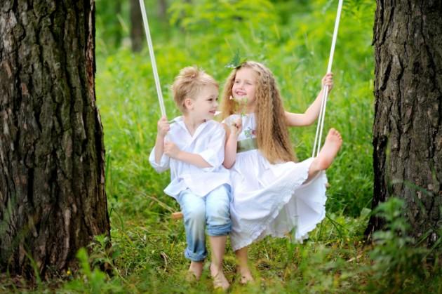 Boy and Girl on Swing